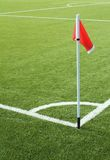 Red flag on the soccer field Stock Images