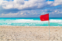 Red flag on a stormy beach Royalty Free Stock Photography