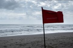 Red flag swimming prohibited on the beach Royalty Free Stock Photography
