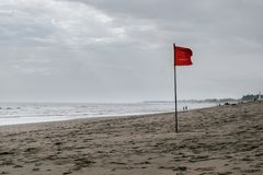 Red flag swimming prohibited on the beach Royalty Free Stock Image