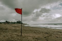 Red flag swimming prohibited on the beach Royalty Free Stock Photos