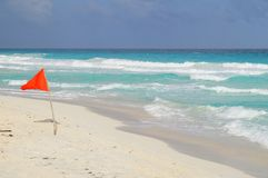 Red flag. For swimming set on the Caribbean shore Stock Image
