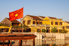 Red flag Thu Bon in Hoi An, Vietnam. Hoi An is located on the coast of the South China Sea. Is recognised as a World Heritage Site by UNESCO. Market at night Royalty Free Stock Photography