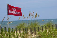 Red Flag Up: No Swimming Royalty Free Stock Photo