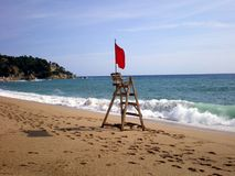Red flag. A red flag warning of an impending storm in the city of Lloret de Mar on the Mediterranean coast in Spain Stock Photos