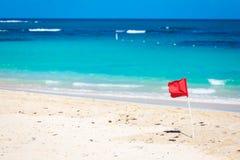 Red Flag warning sign at the beack no swimming. Waves royalty free stock photos