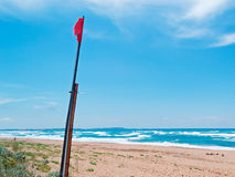 Red flag and wind Stock Photos