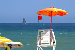 Red flagged lifeguard tower. Red flag on lifeguard post for ground-swell in the sea Royalty Free Stock Photo