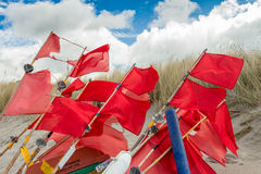 Red Flags at the Beach of baltic sea Royalty Free Stock Photos