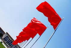Red flags and people's hall Royalty Free Stock Photo