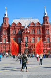 Red flags. Victory day decoration by Historical museum in Moscow. Stock Photos