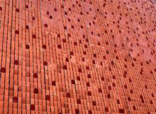 Surface of the flake. Red. Red flake textured background. Decorative surface of the exterior wall of the building Royalty Free Stock Photo