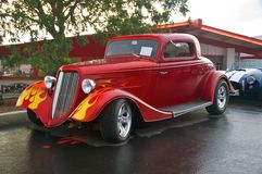 Red Flamed Hotrod in rain Stock Photo