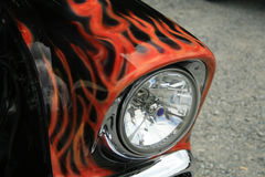 Red flames. On a black car headlight Royalty Free Stock Photos