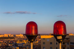 Red flashing aircraft warning lights on the top of skyscraper building Stock Photos