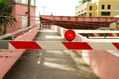 Red flashing barricade light in front of an open drawbridge. Barricade blocking a pedestrian walkway as the drawbridge opens Stock Photo