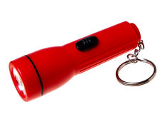 The red flashlight (keychain). Isolated on a white background Stock Photography