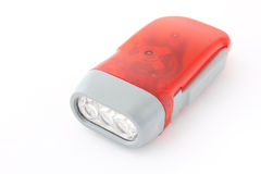 Red flashlight on white Stock Photography