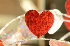 Red flat foil heart on string Close up Stock Photo