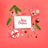 Red Flat lay Christmas. Flat lay Christmas composition with fir tree branches on red holiday background. Top view of Natural design elements. Festive background Stock Images