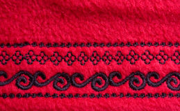 Red fleece fabric. With an embroidery Royalty Free Stock Photography