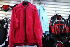 Red fleece jacket. Woman's red fleece jacket hanging in a store stock photography