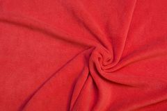 Red fleece texture - close up of a textile background. Pattern Royalty Free Stock Photos
