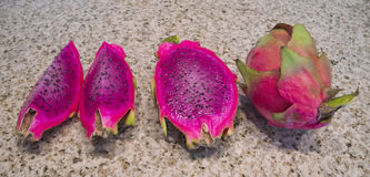 Red-Fleshed Dragon Fruit on Granite Stock Photography