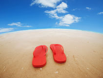 Red flip flops on the beach. Concept of summer vacations.Wide angle royalty free stock photography