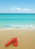 Red flip flops on the beach. Sand.Concept of summer vacations Royalty Free Stock Photography