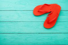 Red flip flops on blue wooden background. Summer holiday. Slippers on the beach. Top view. Mock up. Copy space.  stock image