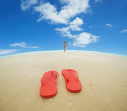 Red flip flops on the beach Royalty Free Stock Photos