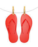 Red flip flops hanging on rope with clothespin Royalty Free Stock Images