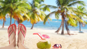 Red flip flops on sandy beach Royalty Free Stock Image