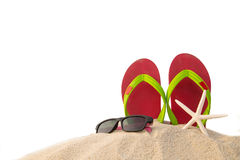 Red flip flops ,sun glass and star fish on beach Royalty Free Stock Photography