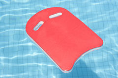 A red float floating in blue pool Stock Image