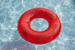 Red float floating in the pool. With blue water Royalty Free Stock Images