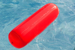 Red float floating in the pool Stock Photo