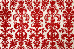 Red flock wallpaper pattern Stock Image