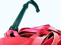 Red Flogger. A red leather flogger with a black leather handle Stock Photography