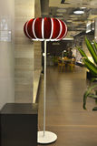 Red floor lamp in shop window Royalty Free Stock Photography