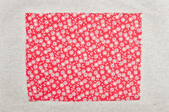 Red floral fabric. Sample on a beige background Stock Photo
