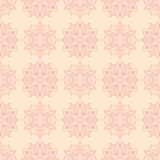 Red floral seamless pattern on beige background. Red floral ornament on beige background. Seamless pattern for textile and wallpapers Royalty Free Stock Photo