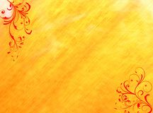 Red floral swirls yellow background. A yellow orange background with big red floral swirls in corners Stock Photos