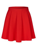 Red flounce skirt on invisible mannequin isolated on white Royalty Free Stock Image