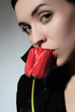 Red flower. A business woman is holding red flower royalty free stock images