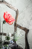 Red Flower, Chair and Wall Stock Images