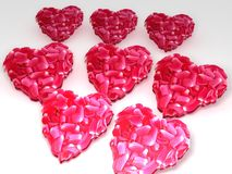 Red flower hearts. A background of red flowered hearts isolated on white Stock Images