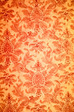 Red flower pattern on the wall Stock Image