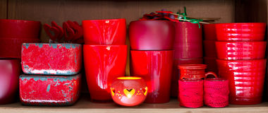 Red flowerpots in the florist store Stock Photography